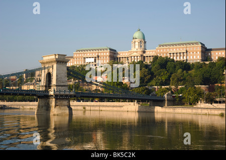 The Chain Bridge over the Danube River and Castle Hill seen from a boat, Budapest, Hungary, Europe - Stock Photo