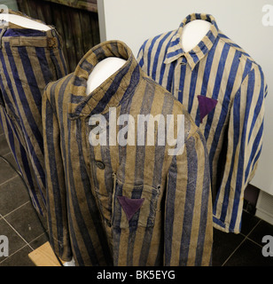 Striped uniforms of concentration camp prisoners on display in museum of Wewelsburg SS castle, Germany - Stock Photo