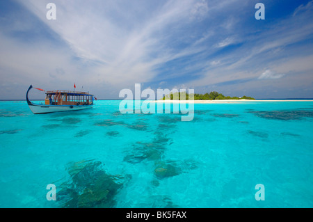 Dhoni and deserted island, Maldives, Indian Ocean, Asia - Stock Photo