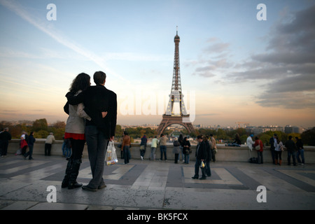 A couple look towards the Eiffel Tower, Paris, France, Europe - Stock Photo
