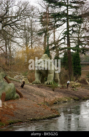 View of the Megalosaurus dinosaur sculpture in Crystal Palace Park in South London - Stock Photo