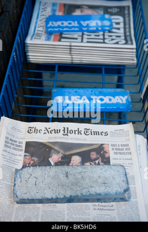 American newspapers on sale in the street - Stock Photo