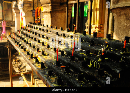 Candle bar in Wat Phra That Lampang Luang temple, Thailand, Southeast Asia - Stock Photo