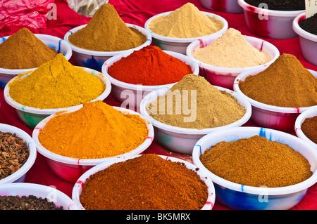 Colourful Indian spices at the Anjuna Flea Market, Goa - Stock Photo