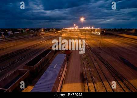 The eastern entrance to Bailey Railway Yard in North Platte, Nebraska, at dusk. The world's largest railroad classification - Stock Photo