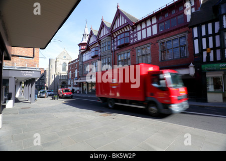 Post Office vehicles traveling along Castle Street in Shrewsbury,fine timber framed buildings form a nice backdrop. - Stock Photo