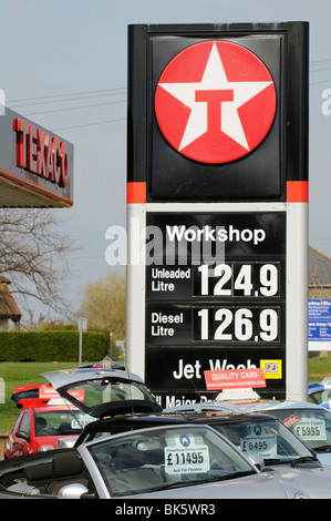 High fuel price sign outside a petrol station in Newport Isle of Wight southern England UK Secondhand used car sales - Stock Photo
