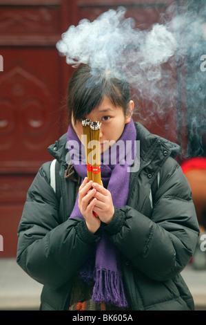 Prayer, Jade Buddha Temple, Shanghai, China, Asia - Stock Photo