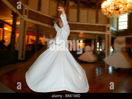 Whirling dervishes at Uskudar's convent, Istanbul, Turkey, Europe - Stock Photo