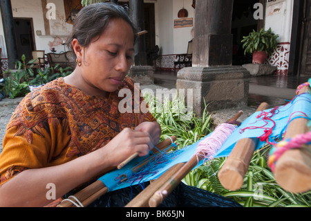 Woman weaving cloth, Antigua, Guatemala, Central America - Stock Photo