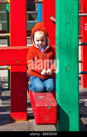 Boy on a slide in Battery Park, Manhattan, New York City - Stock Photo