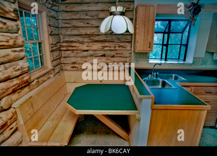 U.S.A. - Single Family House, Interior Kitchen Table, with Log Wood Walls - Stock Photo