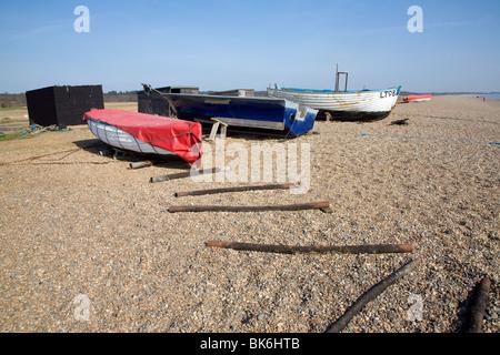 Fishing boats on shingle beach Dunwich, Suffolk - Stock Photo