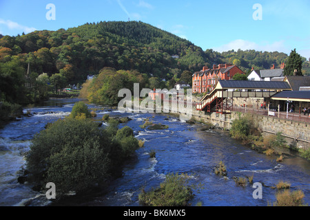 View from the bridge over the river Dee at Llangollen with the railway station on the right - Stock Photo
