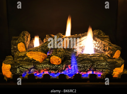 Close up of logs in gas fireplace - Stock Photo
