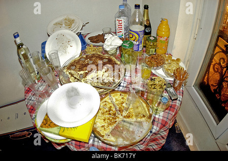 PARIS, France - Messy Food on Table After party Mess - Stock Photo