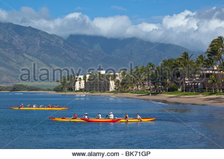 Outrigger canoes at Sugar Beach at the Kihei Canoe Club in Kihei on the island of Maui in the State of Hawaii USA - Stock Photo