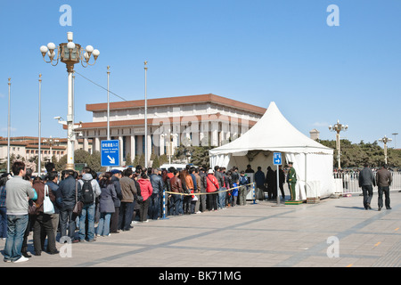 Crowd standing in line to get through the security check point with an X-ray machine by Tiananmen Square in Beijing, - Stock Photo