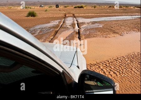 This is an image of an off-road vehicle convoy in the desert. - Stock Photo