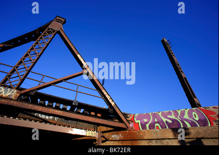 Graffitied rusted railway overpass, Lachine Canal, Montreal, province of Quebec, Canada - Stock Photo