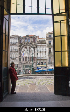 Portuguese man in doorway, São Bento Station, central railway station and historic landmark in Porto (Oporto), Portugal, - Stock Photo