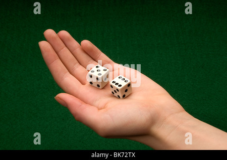 hand holding pair of dice - Stock Photo