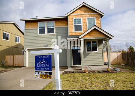 Homes for sale that have been foreclosed on by a local bank, in Bend, Oregon - Stock Photo