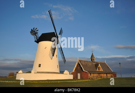 The windmill & boathouse at Lytham bathed in late evening sunshine in spring - Stock Photo