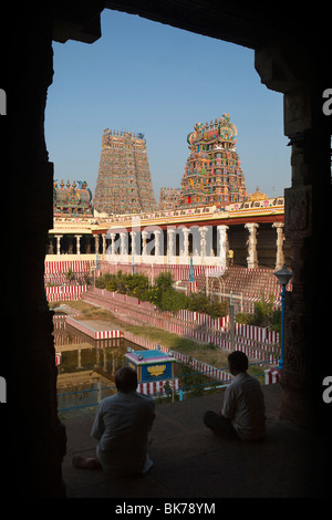 India, Tamil Nadu, Madurai, Sri Meenakshi Temple, central and north gopurams from the Lotus Pool - Stock Photo