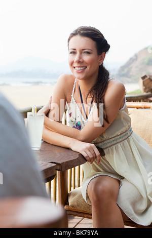 Woman at beach bar - Stock Photo