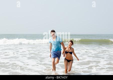 Couple having fun in the sea - Stock Photo