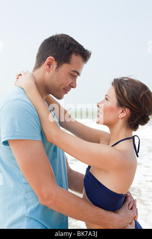 Loving couple by the sea - Stock Photo
