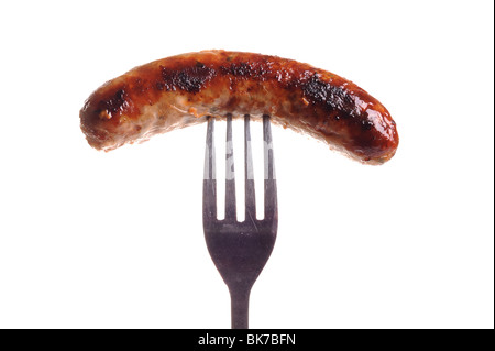 Cooked Sausage on fork - Stock Photo