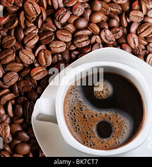 Foam in a cup of coffee as a symbol of yin yang - Stock Photo