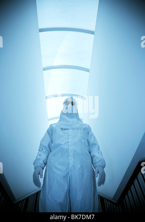 Scientist in an isolation suit - Stock Photo