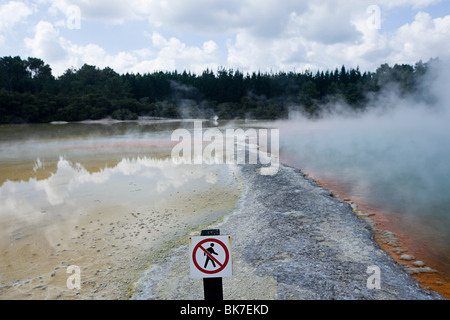 Rotorua, Waiotapu thermal area, Champagne Pool, with sign 'no trespassing' - Stock Photo