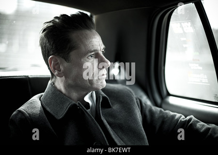 Man in taxi cab - Stock Photo