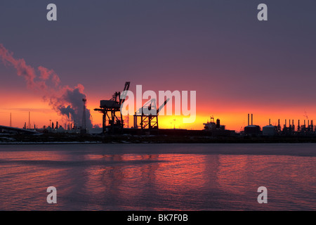 sunset at Hartlepool Docks, Dock Cranes as seen from South Gare, Teesside, North Yorkshire, UK - Stock Photo