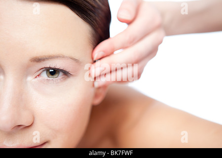 Woman having face massage - Stock Photo