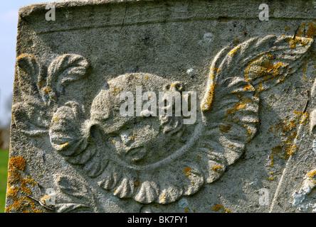 Cherub on gravestone St. Peter and St. Paul churchyard, Preston, Rutland, England, UK - Stock Photo
