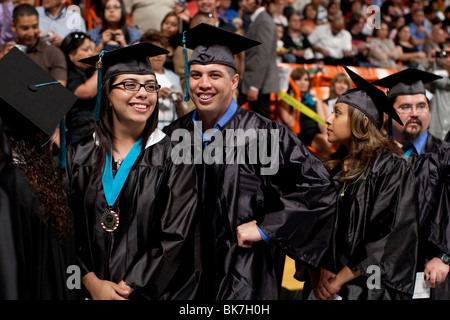 Male and female students wait for their diplomas during graduation ceremony for Mission Community College in El - Stock Photo
