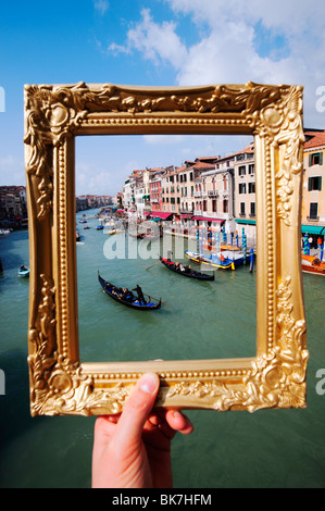 Venice - View of Grand Canal and gondolas in Venice through golden ornate picture frame , Italy - Stock Photo