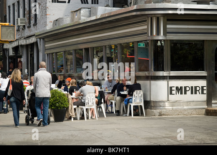 The brunch crowd at he Empire Diner restaurant in Chelsea in New York - Stock Photo