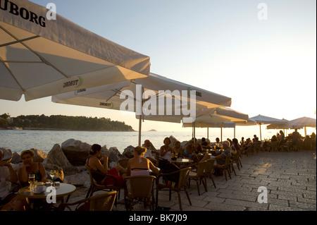 People enjoying sunset at outdoor cafes in Rovinj, Istria, Croatia, Adriatic, Europe