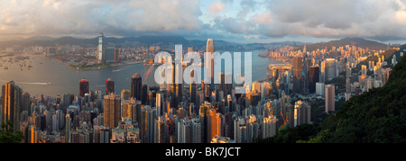 Panoramic view with the illuminated skyline of Central below The Peak, seen from Victoria Peak, Hong Kong, China, - Stock Photo