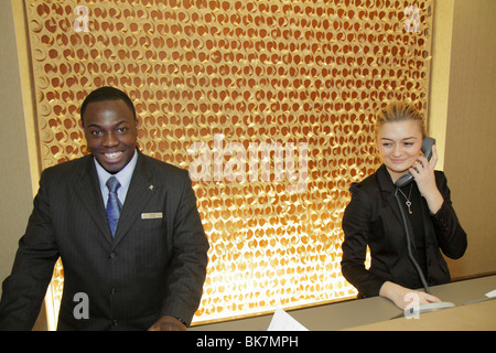 Washington DC 9th Street NW Renaissance Hotel Black man woman clerk front desk job customer service lodging hospitality - Stock Photo