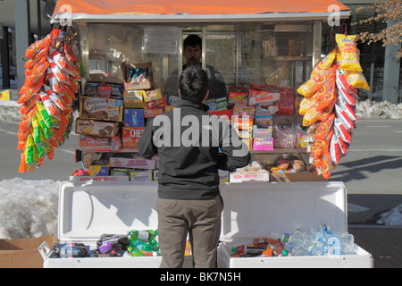 Washington DC 9th Street NW street vendor cart business snack food soft drink soda cooler can package chips candy - Stock Photo