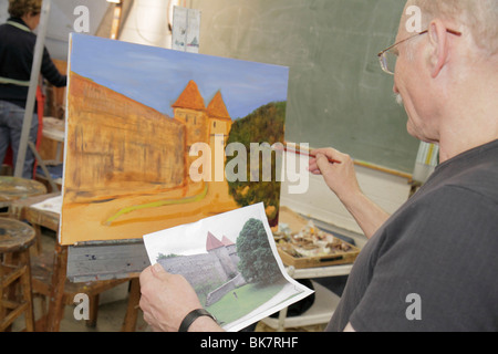 Virginia Alexandria Old Town Alexandria Torpedo Factory Art Center class man easel paintbrush painting castle landscape - Stock Photo
