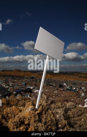 blank sign at British landfill site - Stock Photo