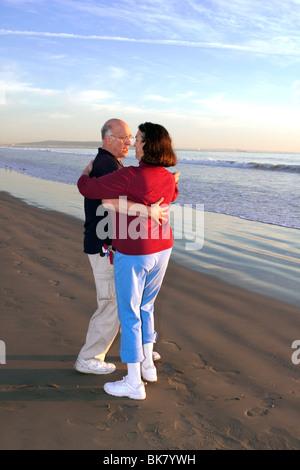 Older couple Dancing on Beach at Sundown - Stock Photo